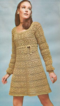 circa 1969 Dress is workind in the round with no side or sleeve seams. Pattern is repeat of filet, shell stitches and borders are single crochet Sized for sizes 8-14 (Bust 30-36) Materials needed: 4 ply knitting worsted - 6-7 4 oz skeins Crochet hooks sizes J and F This item is a