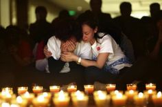 A loved one is lost in an instant. A family member cries as she and other relatives pray during a candlelight vigil for passengers on the missing Malaysia Airlines Flight MH370 in the early morning, at Lido Hotel, in Beijing.