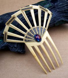 Hey, I found this really awesome Etsy listing at https://www.etsy.com/listing/261410487/art-deco-hair-comb-egyptian-revival