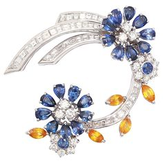 Faraone Floral Yellow and Blue Sapphire Diamond gold Clip   From a unique collection of vintage brooches at https://www.1stdibs.com/jewelry/brooches/brooches/