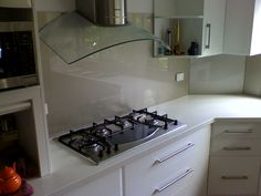 Splashback defined: A sheet of glass, plastic, etc. attached to a wall above a basin to protect the wall against splashing.Backsplash Defined: Paneling, as that attached to the back of a stovetop or to. Kitchen Tiles, Kitchen Cabinets, Kitchen Appliances, Splashback, Home Reno, Master Suite, Basin, Backsplash, Home Kitchens