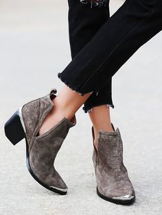 Suede ankle boots with a western-inspired design, etched metal heel and toe caps, and sculptural V-cut sides. Easily bend and mold upper to hold a coveted slouchy shape. *By Jeffrey Campbell Suede Ankle Boots, Bootie Boots, Shoe Boots, Grey Booties, Women's Boots, High Boots, Cowboy Boots, Pointy Boots, Heel Boot