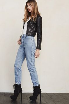 """It's a real power move to wear mom jeans. It says """"I know I'm a babe and don't need skin-tight jeans to prove it"""". The Mom Jean is a vintage jean that we hand pick and show a lot of love to. The fit is high waisted, loose in the hips and tapered at the leg. Cuz you're a hot mama and you know it.    https://www.thereformation.com/products/mom-jean-worn-vintage?utm_source=pinterest&utm_medium=organic&utm_campaign=PinterestOwnedPins"""