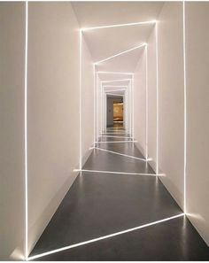 Beiersdorf offices in Athens,Greece, with led stripes incorporated into the concrete floor and drywall creating the effect of natural light entering through cuts on the wall - design and implementation by the Love.it team. Loft Design, Deco Design, Design Offices, Coridor Design, Hotel Lobby Interior Design, Modern Hotel Lobby, Office Wall Design, Luxury Hotel Design, Urban Design