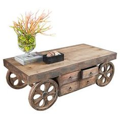 """Distressed wood coffee table with wheel accents.   Product: Coffee tableConstruction Material: WoodColor: Brown Features:  Distressed finish Four drawers  Dimensions: 16"""" H x 47.5"""" W x 25"""" DNote: Accents pictured are not  included"""