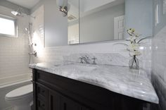 Carrera Marble with Water Fall Edge Vanity Top and Chrome Faucets