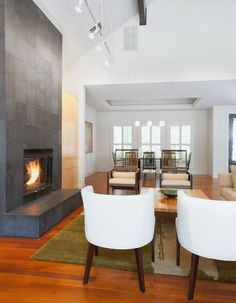 Love the simplicity of this fireplace!  With contemporary designs, you don't find a hearth too often, but it's one thing I really would like to have.