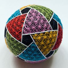 This temari ball measures approximately 11 cm (4.5) in diameter. Temari is the traditional Japanese art of embroidering thread balls. Originally