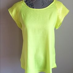 Express Neon Yellow Sequin Top Neon Yellow with sequins on the sleeves. Zippered detailing on the back. Wear for a night on the town or to work. I own many of these shirts in different colors and they are my favorite tops from Express. Express Tops Blouses