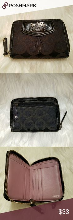 Coach Madison Op Art Bifold Zip Wallet This is a Madison, black, Op Art Medium Wallet that features a sateen fabric and leather exterior, zip closure and a leather interior.  The exterior includes the iconic stagecoach logo and zip coin pocket.  The inside is a pretty lilac leather with room for currency, 6 credit cards, and 4 additional areas to stash more cards. The only wear is the slight darkening of the edge of the coin pocket caused by storing dirty coins! fcex22x Coach Bags Wallets