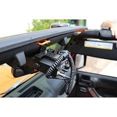 Rugged Ridge 11503.95 Radio Mounting Bracket, CB; 07-18 Jeep Wrangler JK CB Radio Mount: CB radio mount conveniently mounts over the rearview mirror for easy reach and provides a hidden mounting point for your CB. Coated Steel: Made from steel with a durable black powder coat finish. The CB mount is within reach without having to take your eyes off the road or trail. Features a hooked end to secure CB handset cord Off-road Accessories: Get serious about off-roading with a variety of tow hooks, h Jeep Wrangler Interior, 2017 Jeep Wrangler, Jeep Jk, Jeep Wrangler Unlimited, Wrangler Rubicon, Jeep Wrangler Accessories, Jeep Accessories, Accessories Online, Raiders