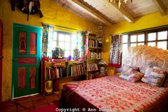 San Miguel de Allende, Guanajuato, Mexico: The guest bedroom of the eclectic home of Anado McLauchlin and his husband Richard Schultz also uses a bright pallate and global art. Photo Ann Summa