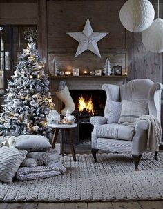 Cozy and stylish Christmas tree in front of fireplace in all shades of grey