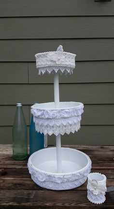 goodwill cake pans altered with paint, dowel and lace, storage or cupcake treat stand