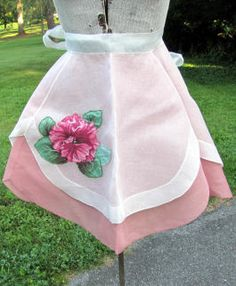 Vintage apron with appliqued chintz flower on white organdy over a dusty rose cotton.
