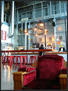 Interior design | decoration | cafe in australia. cinema style arm chairs. industrial.