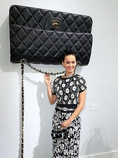 BAG LADY My, what a large purse you have, Katy! Perry gets playful on Tuesday morning while arriving at the Chanel runway show during Paris Fashion Week.