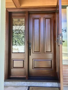 Very handsome #custom #mahogany #AmberwoodDoor with STORM DOOR shown open here; San Miguel stain; Clear glass on Storm Door; Taffeta glass with internal Wrought iron; & strong #Emtek lockset! Call or come into Amberwood\'s outstanding #showroom this #Summer2018 for your beautiful #customdoors 416-213-8007 #AmberwoodDoors proudly ships #worldwide - Call today for shipping details! 1-800-861-3591 #DoorsOfDistinction #DoorsOfTheWorld #MadeInCanada #Toronto #Architecture #HouseBeautiful #CurbAppeal
