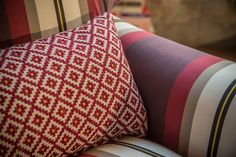 Cushion in CORTE fabric: small #geometric appealing, presented in bright colors and mélange. Rustic flavor, is made with 100% natural fibers. Ideal for upholstery.  Armchair in PAGGIO #fabric: elegant and modern #stripes 100% #cotton, perfect for precious #curtains and #upholstery.