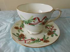 Duchess pinecone and Holly ribbon pattern cup saucer