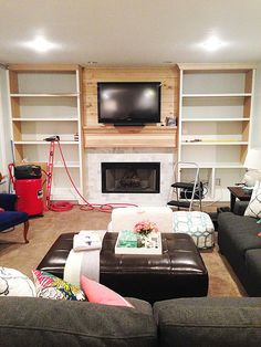 A video tutorial for how to create DIY built-ins around a fireplace, including an IKEA hack.