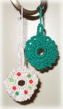 Use small amounts of yarn to crochet pretty mini Christmas wreaths for your Christmas tree or gifts.