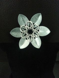 Steel and aluminum flower about 2 in.