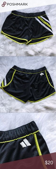 Adidas shorts Adidas mesh gym shorts. White and yellow stripes. Logo on back side is slightly peeled off. Other than that, great condition, super comfortable. Open to reasonable offers adidas Shorts