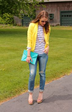 Bright yellow blazer with stripes and a teal clutch...love
