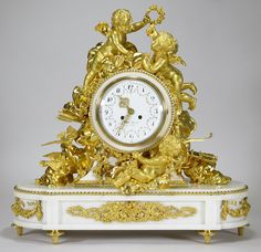 An Important and Palatial French Louis XV Style 19th Century Gilt-Bronze White Marble Mantel Clock Attributed to Alfred-Emmanuel-Louis Beurdeley, the casting and gilding by Jules Graux, Paris, The Movement by Japy Freres & Cie. The large and impressive marble and two-tone finely chased gilt-bronze and white marble body, with it's original superb quality mercury satin-gilt and burnished gilt, surmounted by two reclining cherubs amongst clouds, one holding a triumphant wreath the other a…