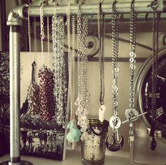 Industrial metal pipe makes an interesting, modern jewelry display.