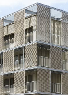 completely remodeling the facade of this social housing block in paris, french firm atelier du pont have added a new skin of balconies over the existing structure. the intervention to this seriously degraded building, which contains 56 units in the saint-blaise neighbourhood