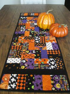 This table runner has to many Halloween prints to count and its a perfect table runner for the Halloween season. Works well on any table in the house, kitchen table, dining room, sofa table or the coffee table. Great place to put the pumpkin the kids carved or just a bowl of candy corn, fall flowers or a grouping of candles, just let your imagination run. All the fabrics are 100% cotton and the batting is Warm & Natural cotton batting. Machine wash and dry, can be ironed on a cotton sett...