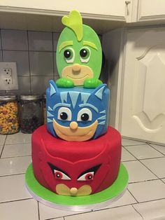 Our cake turned out AWESOME. Found on Pinterest and had someone make it. PJ Masks Birthday Party . #PJMASKS #Birthday