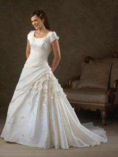 This wedding dress is absolutely beautiful! Very elegant, that's for sure.