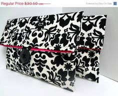 Hey, I found this really awesome Etsy listing at https://www.etsy.com/listing/170910092/on-sale-damask-clutches-in-black-and