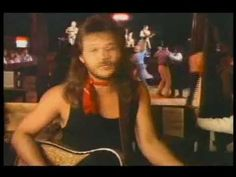 Travis Tritt - Country Club    This was the first big hit for Travis Tritt, in 1990. This launched his career into the stratosphere, eventually earning him a place in the Grand Ole Opry.