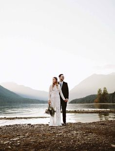 Pacific Northwest Wedding - this couple's wedding portraits on the lake are the most gorgeous, romantic and bohemian photos we've ever seen. Look at the mountains in the background!