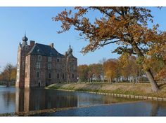 Castle Cannenburgh - back to the Middle Ages  \\  We always like to visit 'Castle Cannenburgh' in the village of Vaassen, less than 10 km's north of Apeldoorn. It is a real old castle, already built in the 15th century by Marshal Marten van Rossem. This classic castle, surrounded by a moat, has still the spirit of a medieval place with its old brick walls. The castle can be vistied and you will be impressed by the interior with lots of furniture, paintings and porcelain.