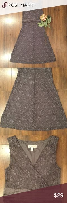 """🌹Pretty in Pewter Lace Dress 🌹 Stunning lace Isaac Mizrahi tea length dress. Features pleated waistline, side zipper, fully lined, conservative neckline. Lace slightly shimmers in the light. Great for any special event. Measures approximately 43"""" long. Hand wash and dry flat. Lining Made from 100% polyester. Shell made from 100% Nylon. No trades, low-ball offers or modeling. Thanks for shopping in my closet! Happy Poshing ladies! 😘 Isaac Mizrahi Dresses Midi"""