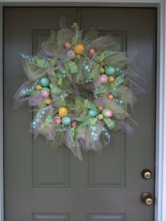 This pretty wreath was made by a reader named Angela. Everything coordinates beautifully. The tulle works out perfectly... It gives it a wispy look. I ove the simplicity of this one with just the ribbons and eggs. Gorgeous!!