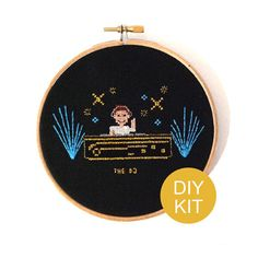 DIY cross stitch kit from our modern job series - it features the DJ pattern . the golden metallic floss will shine in the light. This DJ is ready to create a party at your home!