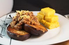 Grilled Marinated Aubergine Steaks topped with Black Olive and Lentil Tapenade served with Rosemary Herbed Polenta Squares.