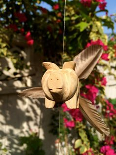 Wood Flying Pigs Mobile / Wind Spinner ~ When Pigs Fly!   Hand carved in Northern Thailand by rice farmers in their slow season ~ these wonderful pigs are sure to add cheer to any home.  Made in Thailand - Ships from U.S.A