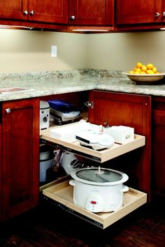 Glide-Out Solutions for the Kitchen | Shelfgenie of Philadelphia ; I don't see how you get to the appliances in the back easily.  It looks like the front drawers would have to come off
