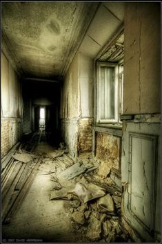 Belgium. Castle Miranda.  A long corridor, likely once hung with pictures, is now a haven of decay and rot. The stone is crumbling and mildew seeps in to add to the atmosphere of forgotten lives and dreams.  Read more at http://www.environmentalgraffiti.com/news-castle-miranda#BvBhqlH1LzLjEKcA.99