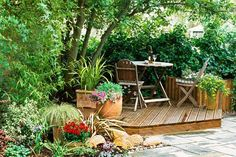 Even a small corner in the backyard can become a destination with decking and comfy furnishings.