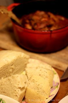 Steamed bread is a partly moist, partly not kind of part bread/dumpling-feel dish. Though not exclusively South African, I've only eaten it in this context. It is a less weighty accompaniment to stews than pap. I had it with lamb bredie and it was excellent.
