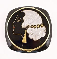 1920s French compact, engraved and painted black celluloid, celluloid sifter, mirror. 2 7/8 in