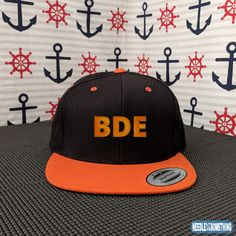 Do you have that strong BDE??  BIG energy, you need it to flourish in this world.   A bright orange bill and snapback closure accentuates the powerful energy you have cooped up within.  Harness your energy from down under and become an Alpha Male!    #BDE #BigDickEnergy #Energy #Funny #Memes #Orange #Powerful #HighQuality #Snapbacks #Hats #Caps #Embroidered #Gifts